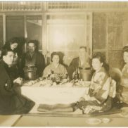 Victor Delnore's wife, Catherine, center, at a Japanese-style meal