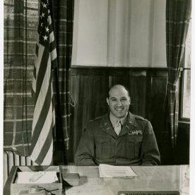 Victor Delnore at his desk in Nagasaki